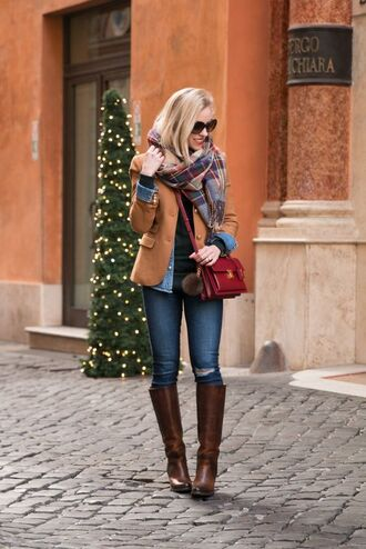 shoes knee length boots brown leather boots leather boots blue skinny jeans camel blazer red satchel crossbody bag denim jacket frye skinny jeans plaid scarfs oversized sunglasses black knitted top