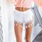 White tassel detail crochet lace shorts