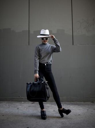 la vagabond dame blogger striped sweater fedora maxi bag black bag