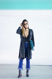 little black boots,blogger,jeans,bag,coat,frayed jeans,cropped jeans,blue jeans,plunge v neck,black top,v neck,black choker,choker necklace,trench coat,black coat,clutch,furry pouch,sunglasses,boots,high heels boots,black boots,fall outfits,date outfit,jewels,necklace,jewelry,furry bag