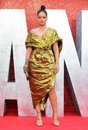 dress,asymmetrical,asymmetrical dress,wrap dress,sandals,sandal heels,rihanna,off the shoulder,bustier,red carpet dress,red carpet,gold,gold dress