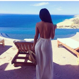 pants white butt tan sun back chair sand destination dress jumpsuit white jumpsuit long hair tanned girl beach hat straw hat backless sunglasses holidays beige n'use summer summer dress romper nude style one piece white dress maxi dress backless dress