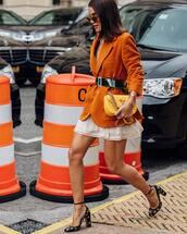 jacket,blazer,pockets,mini skirt,high heels,belt,clutch,sunglasses
