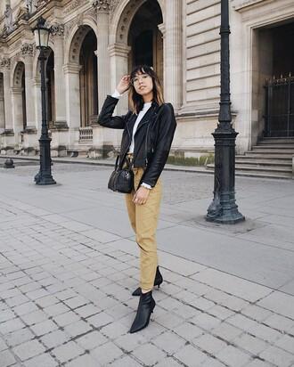 pants black jacket yellow yellow pants boots black boots ankle boots jacket leather jacket black leather jacket bag black bag