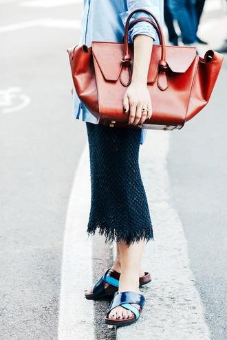 le fashion image blogger brown bag button up long sleeves fringe skirt sandals pencil skirt maxi bag brown leather bag midi skirt slide shoes patent shoes blue shirt black skirt