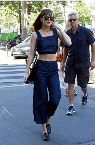 top dakota johnson bag sunglasses crop tops shoes loafers blue top blue pants black bag black shoulder bag