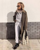 coat,wool coat,double breasted,joggers,sweater,boots,handbag,snake print,sunglasses