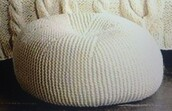 home accessory,chair,beanie,white,room accessoires,knitwear,knitted pillow,round pillow