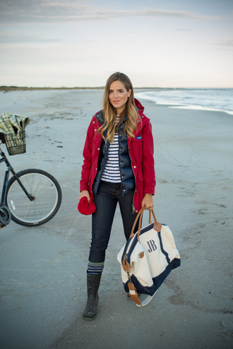 gal meets glam blogger socks wellies down jacket red coat maxi bag stripes beach winter outfits travel bag