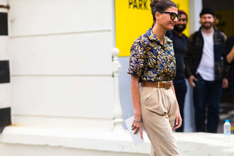 shirt fashion week street style fashion week 2016 fashion week london fashion week 2016 short sleeve printed shirt pants nude pants belt high waisted pants sunglasses streetstyle fall outfits