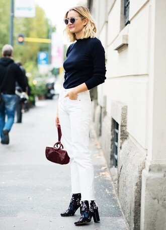 jeans cropped bootcut white jeans cropped jeans cropped bootcut jeans white jeans top black top long sleeves boots adenorah blogger streetstyle fall outfits printed boots