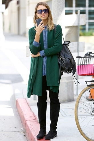 shirt cardigan denim shirt jessica alba boots backpack bag fringe backpack black backpack fringes green carigan long cardigan black jeans jeans knee high boots black boots blue shirt sunglasses celebrity style celebrity fall outfits