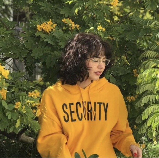 sweater yellow security sweatshirt red dress worn by enya enjajaja enya s