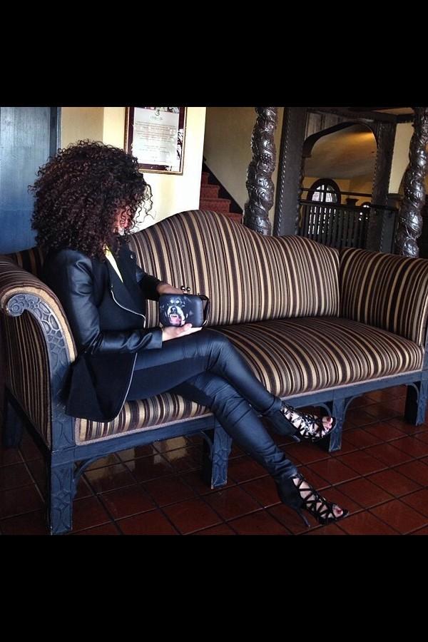coat black pants shoes curly hair jacket