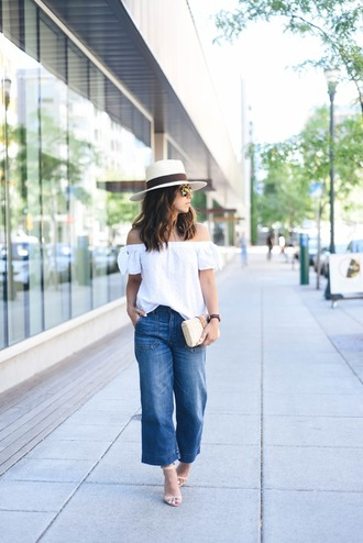 crystalin marie blogger hat bag shoes off the shoulder wide-leg pants white hat sandals round sunglasses white top white off shoulder top off the shoulder top summer top cropped jeans cropped bootcut blue jeans cropped bootcut jeans sandal heels high heel sandals nude sandals