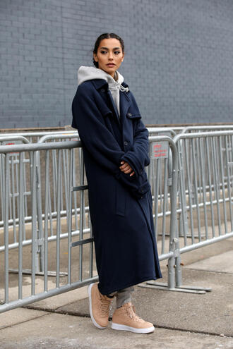 coat nyfw 2017 blue coat fashion week 2017 fashion week streetstyle navy navy coat blue long coat long coat hoodie grey hoodie sneakers nude sneakers