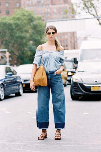vanessa jackman blogger shirt top jeans pants shoes cropped flared jeans blue off shoulder top brown bag aviator sunglasses sunglasses denim top denim shirt blue shirt cropped jeans blue jeans streetstyle spring outfits sandals flat sandals brown sandals denim culottes