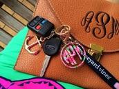 bag,monogram leather clutch,clutch,monogramed key chain,keychain