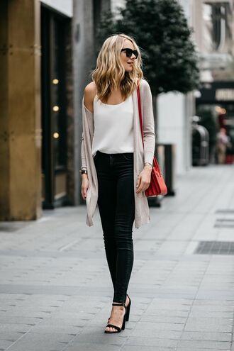 shoes beige cardigan black skinny jeans red bag strappy black heels sunglasses blogger