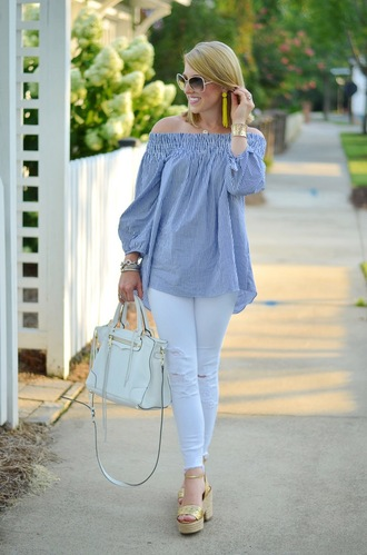 something delightful blogger bag jewels shoes sunglasses off the shoulder long sleeves white bag wedges ripped jeans blue top off the shoulder top light blue jeans white jeans white ripped jeans white sunglasses handbag spring outfits earrings statement earrings sandals gold sandals gold high heel sandals blue off shoulder top puffed sleeves accent earrings
