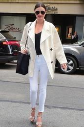 jumpsuit,pants,jeans,white jeans,miranda kerr,wedges,sandals,jacket,shoes