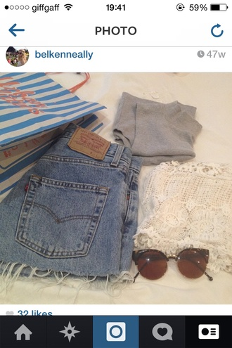 levis high waisted jeans ripped loose tanned bits hanging off sunglasses light blue light top