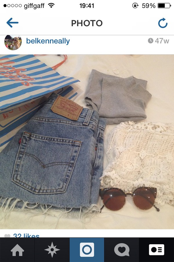 levi's high waisted jeans ripped loose tanned bits hanging off sunglasses light blue light top