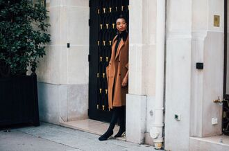 coat fashion week street style fashion week 2016 fashion week paris fashion week 2016 brown coat fall coat fall outfits earrings boots black boots high heels boots streetstyle tumblr opaque tights
