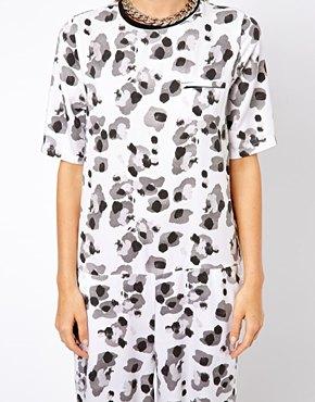 ASOS   ASOS Wide Leg Jumpsuit in white leopard print at ASOS