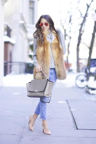 something navy blogger faux fur vest purse nude high heels mirrored sunglasses jeans jacket shoes bag sunglasses jewels beige fur vest