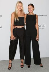 top,gigi hadid,bella hadid,black jumpsuit,black top,shoes,black shoes,clutch,black pants,crop tops,jumpsuit,all black everything,hadid sisters,wide-leg pants,gigi and bella hadid,celebrity,black crop top,pants,cropped pants,high waisted pants,sandal heels,pumps,black sandals,black pumps