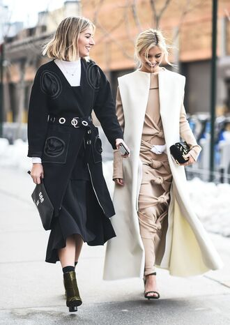 coat white vest long vest nyfw 2017 fashion week 2017 fashion week streetstyle vest dress nude dress long sleeves long sleeve dress maxi dress sandals sandal heels high heel sandals black sandals skirt black skirt midi skirt black coat belt boots velvet velvet shoes velvet boots bag black bag