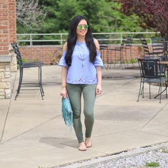 morepiecesofme blogger sunglasses jewels bag top shoes blue top clutch fringed bag spring outfits green pants