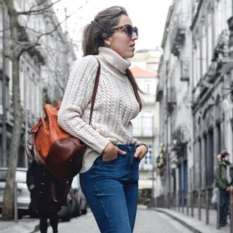 bag sustainable backpack leather backpack brown backpack sweater white sweater cable knit white cable knit sweater denim jeans blue jeans sunglasses tortoise shell sunglasses tortoise shell