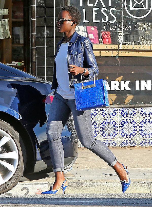 lupita nyong'o grey jeans blue bag leather jacket bag shoes jacket