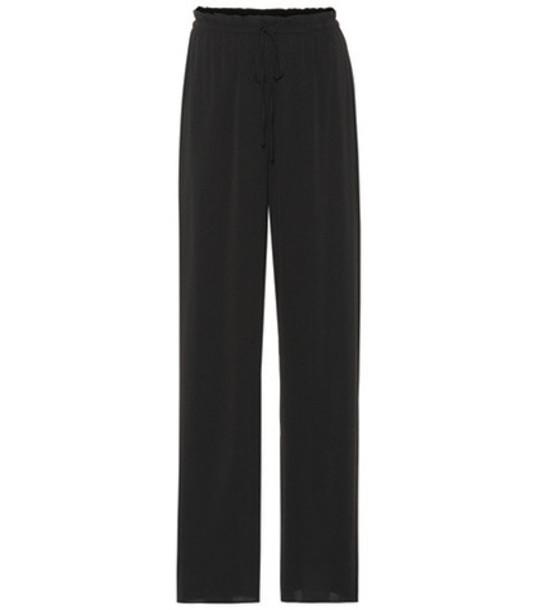 The Row JR stretch silk pants in black