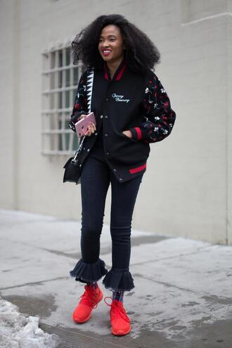 jeans nyfw 2017 fashion week 2017 fashion week streetstyle denim blue jeans jacket baseball jacket black jacket bomber jacket black bomber jacket sneakers red sneakers ruffle