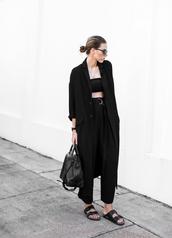 flats,minimalist,boyish,black pants,high waisted pants,black coat,coat,belt,top,sunglasses,jewels,slide shoes,black slides,androgynous,birkenstocks,givenchy bag