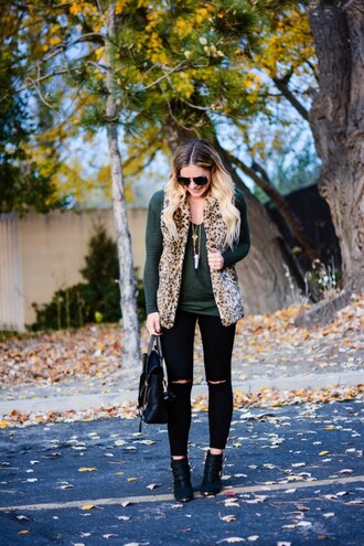 all dolled up blogger jacket jewels sunglasses bag shoes faux fur vest fall outfits ankle boots black jeans printed fur vest