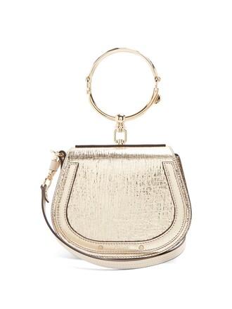 cross metallic bag leather gold