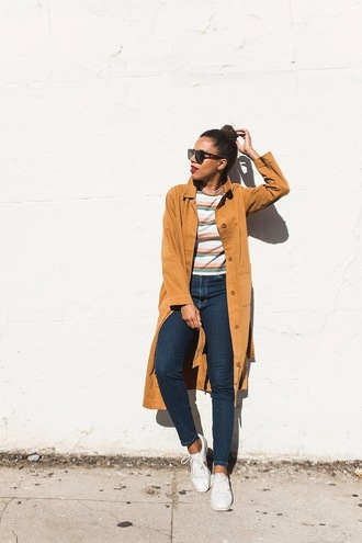 coat tumblr trench coat mustard top stripes striped top denim jeans blue jeans sneakers white sneakers low top sneakers sunglasses