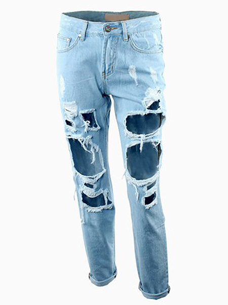 Light blue boyfriend style ripped jeans with broken hole