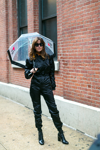 jumpsuit nyfw 2017 fashion week 2017 fashion week streetstyle black jumpsuit sunglasses boots black boots high heels boots umbrella