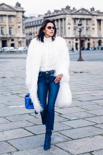 viva luxury blogger blouse jewels fur coat white coat skinny jeans blue bag loewe bag white fur coat coat shirt white shirt blue jeans cropped bootcut jeans cropped bootcut blue jeans boots blue boots sunglasses winter outfits streetstyle winter sweater winter look