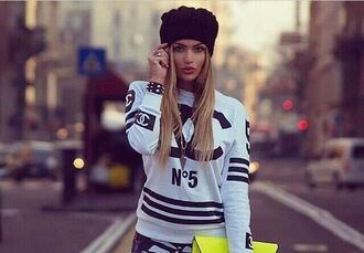 sweater chanel inspired white sweater shirt baseball shirt black and white bag sweatshirt chanel black letters sporty shirt blonde hair n5 crazy pattern stripes neon yellow bag urban pants leggings clothes girly coco channel no5 shirt white chanel sweater