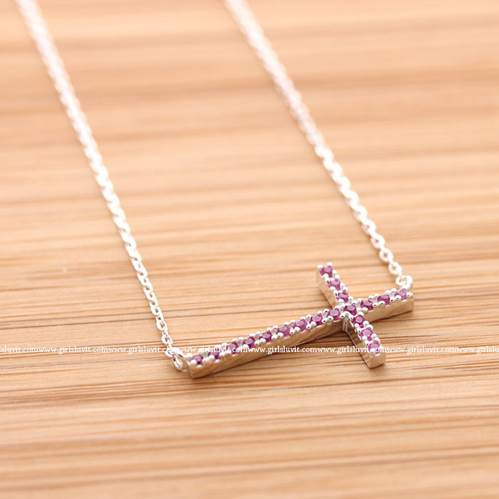 Sideways cross necklace with pink crystals