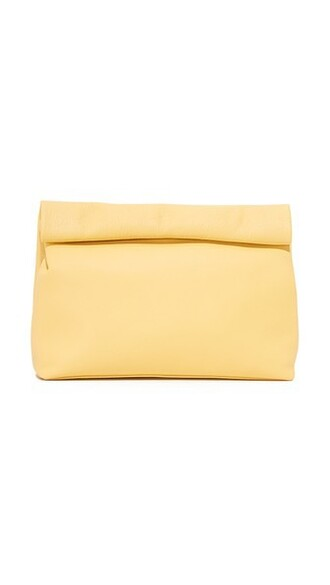 pale clutch yellow bag