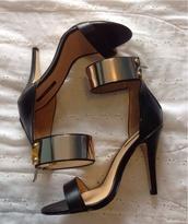 sandal heels,sandals,high heels,metallic shoes,black heels,shoes,gold shoes,cardigan