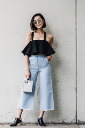 le fashion image,blogger,sunglasses,ruffle,black top,high waisted jeans,wide-leg pants,thick heel,mini bag,mirrored sunglasses,culottes,frayed denim,outfit idea,ruffled top,off the shoulder,silver sunglasses,mules,grey bag,handbag,crop tops,black crop top,dior sunglasses,palazzo pants,denim culottes
