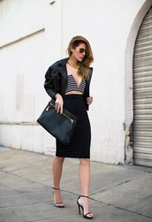blogger,stripes,chain,pencil skirt,black skirt,crop tops,bustier,black jacket,pouch,bachelorette party outfits,necklace,gold necklace,chain necklace,black leather jacket,leather jacket,midi skirt,bodycon skirt,tube top,v neck,plunge v neck,party outfits,sexy outfit